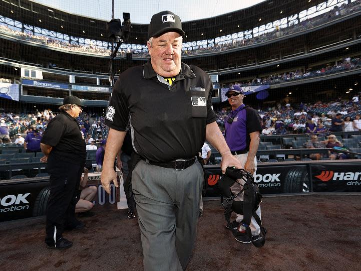 Joe West, who recently umpired his 5,00th career game, avoided injury after being hit in the head by a baseball thrown from the stands. (AP)