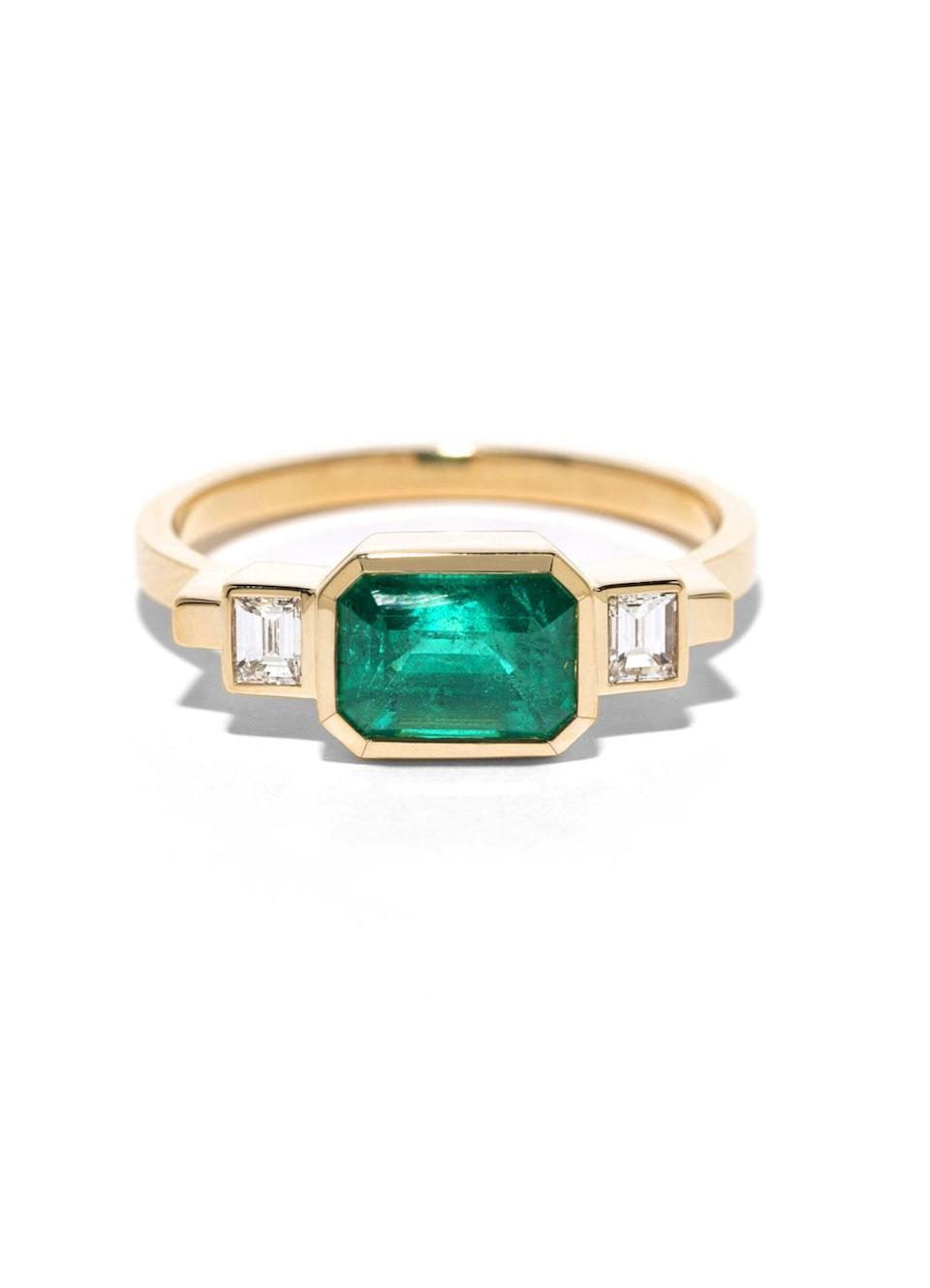 """Once thought of only as an accent, gemstones are now taking center stage in the engagement ring world. Isom Johnson predicts they'll """"become staples for engagement rings."""" $4200, Azlee. <a href=""""http://azleejewelry.com/rings/emerald-and-baguette-diamond-ring"""" rel=""""nofollow noopener"""" target=""""_blank"""" data-ylk=""""slk:Get it now!"""" class=""""link rapid-noclick-resp"""">Get it now!</a>"""
