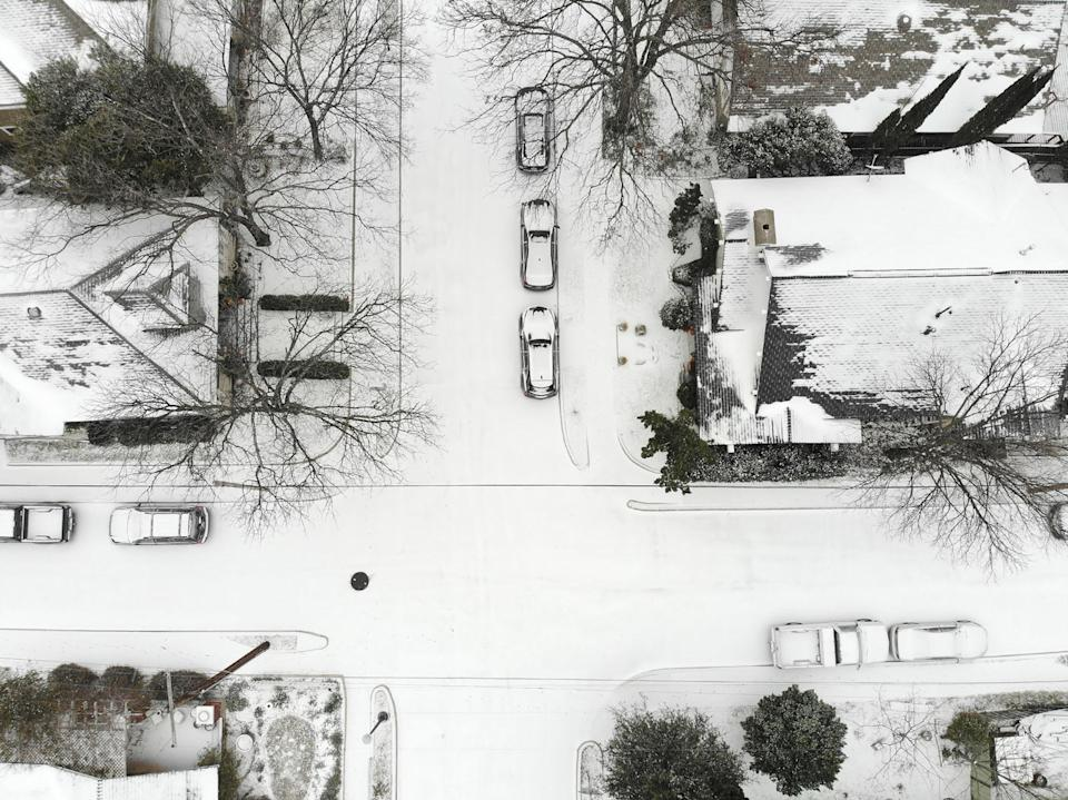 A layer of snow coats the ground in the Fairmount neighbourhood of Fort Worth, Texas, on February 14. Source: ABACA/PA