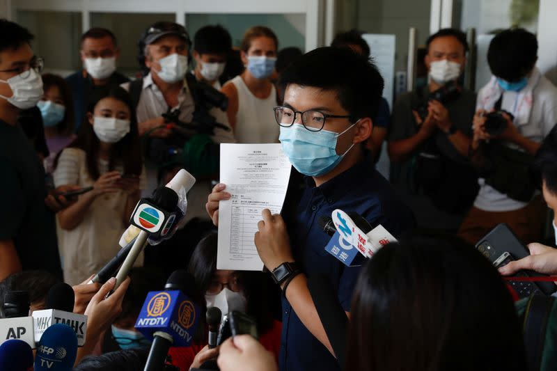 FILE PHOTO: Pro-democracy activist Joshua Wong registers as a candidate for the upcoming Legislative Council election in Hong Kong