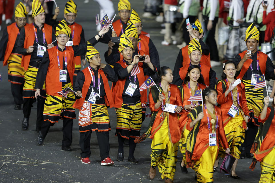 Athletes from Malaysia march in a parade during the Opening Ceremony at the 2012 Summer Olympics, Friday, July 27, 2012, in London. (AP Photo/Mark Humphrey)