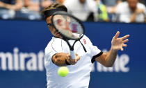 Roger Federer, of Switzerland, returns to David Goffin, of Belgium, during the fourth round of the US Open tennis championships Sunday, Sept. 1, 2019, in New York. (AP Photo/Sarah Stier)