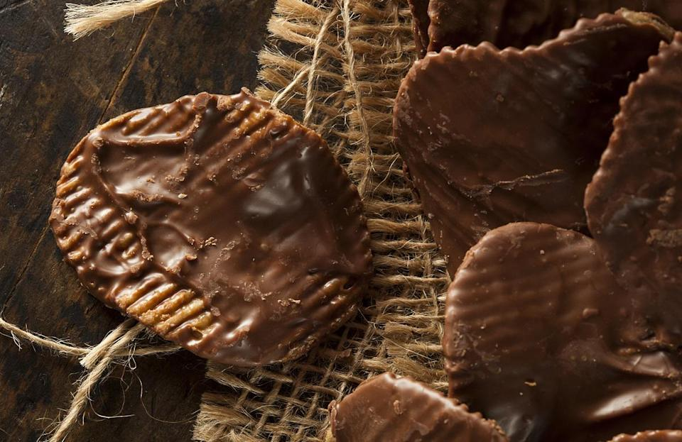 "<p>The most iconic dessert in North Dakota seamlessly blends sweet and salty flavors into one notable treat: chippers. The snack pays homage to North Dakota's agricultural history and can be found at Widman's Candy Co., one of the <a href=""https://www.thedailymeal.com/eat/best-chocolate-shop-every-state-gallery?referrer=yahoo&category=beauty_food&include_utm=1&utm_medium=referral&utm_source=yahoo&utm_campaign=feed"" rel=""nofollow noopener"" target=""_blank"" data-ylk=""slk:best chocolate shops in America"" class=""link rapid-noclick-resp"">best chocolate shops in America</a>.</p> <p><a href=""https://www.thedailymeal.com/best-recipes/chippers?referrer=yahoo&category=beauty_food&include_utm=1&utm_medium=referral&utm_source=yahoo&utm_campaign=feed"" rel=""nofollow noopener"" target=""_blank"" data-ylk=""slk:For the Chippers recipe, click here"" class=""link rapid-noclick-resp"">For the Chippers recipe, click here</a>.</p>"