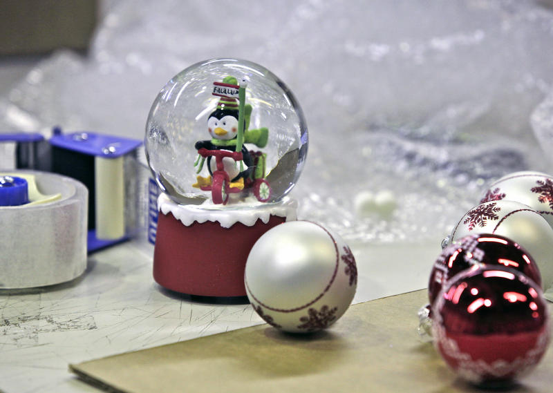 This Dec. 11, 2012 photo shows holiday decorations that survived repeated drops of an impact taster at the UPS Package Design and Testing Lab in Addison, Ill. UPS tests new packaging designs by dropping, shaking and smashing boxes with brutal-looking equipment to see what type of packaging can withstand the trip from supplier to customer, protecting the delicate products inside.  (AP Photo/Teresa Crawford)