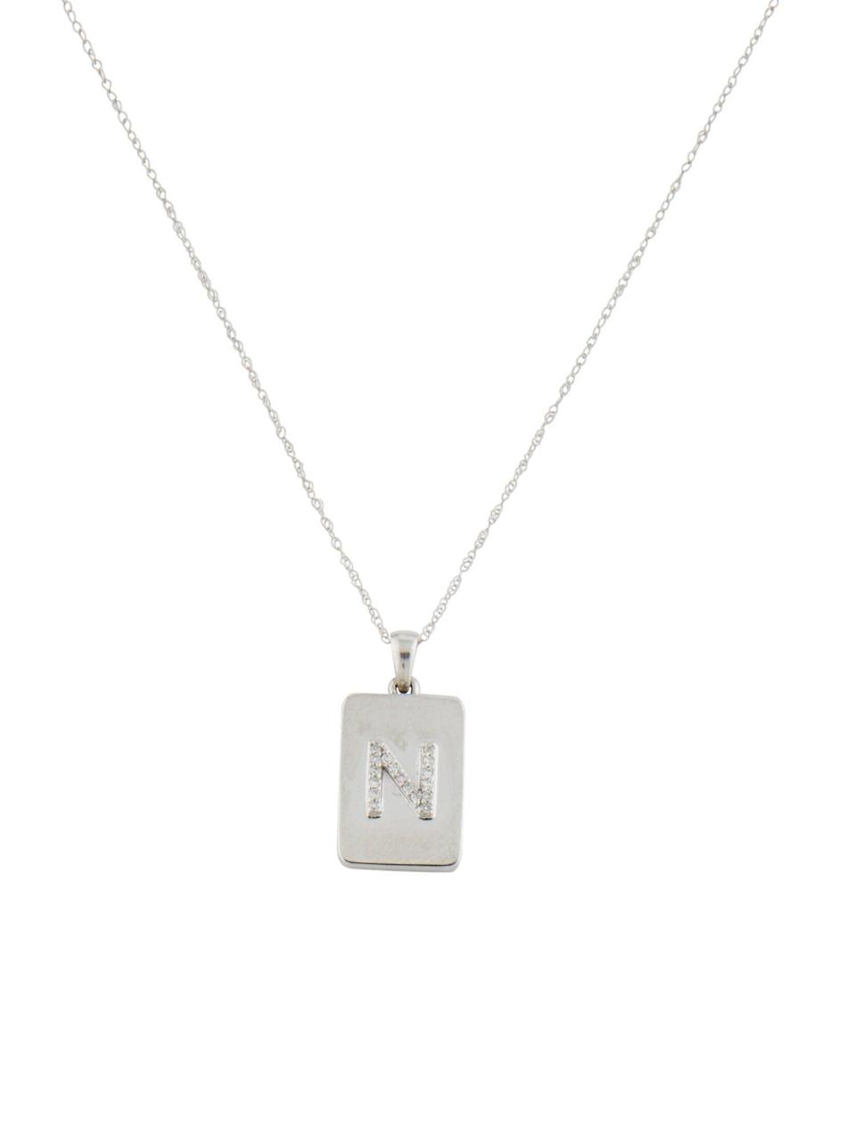 "<br><br><strong>The RealReal</strong> Rhodium-Plated 14K White Gold Initial 'N' Pendant Neckl, $, available at <a href=""https://go.skimresources.com/?id=30283X879131&url=https%3A%2F%2Fwww.therealreal.com%2Fproducts%2Fjewelry%2Fnecklaces%2Fpendant-necklace%2F14k-diamond-initial-n-pendant-necklace-7z4tx%3Fposition%3D76%23%21"" rel=""nofollow noopener"" target=""_blank"" data-ylk=""slk:The RealReal"" class=""link rapid-noclick-resp"">The RealReal</a>"
