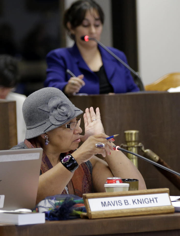 Texas Board of Education member Mavis Knight takes part in meetings, Thursday, Nov. 21, 2013, in Austin, Texas. The Board of Education is casting critical votes on new science textbooks for use statewide, and on whether algebra II should be a required high school course.(AP Photo/Eric Gay)