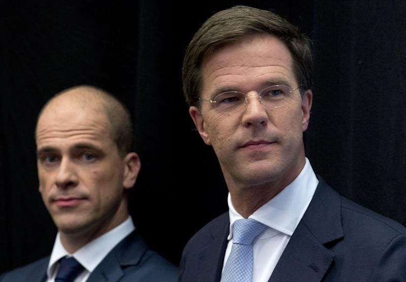 Netherlands' caretaker Prime Minister Mark Rutte, right, and Labor Party Leader Diederik Samsom, left, attend a joint news conference in The Hague, Netherlands, Monday Oct. 29, 2012. The Netherlands is close to getting a new coalition government after lawmakers from the two biggest parties approved a policy deal hammered out by their leaders. Rutte, leader of the pro-free market VVD party, and center-left Labor Party chief Samsom have been negotiating behind closed doors for weeks to resolve policies for their proposed coalition. (AP Photo/Peter Dejong)