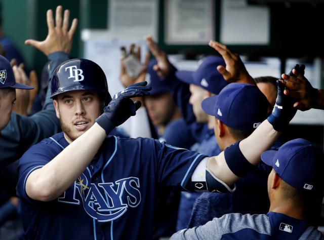 Tampa Bay Rays' C.J. Cron celebrates in the dugout after hitting a two-run home run during the first inning of a baseball game against the Kansas City Royals Tuesday, May 15, 2018, in Kansas City, Mo. (AP Photo/Charlie Riedel)