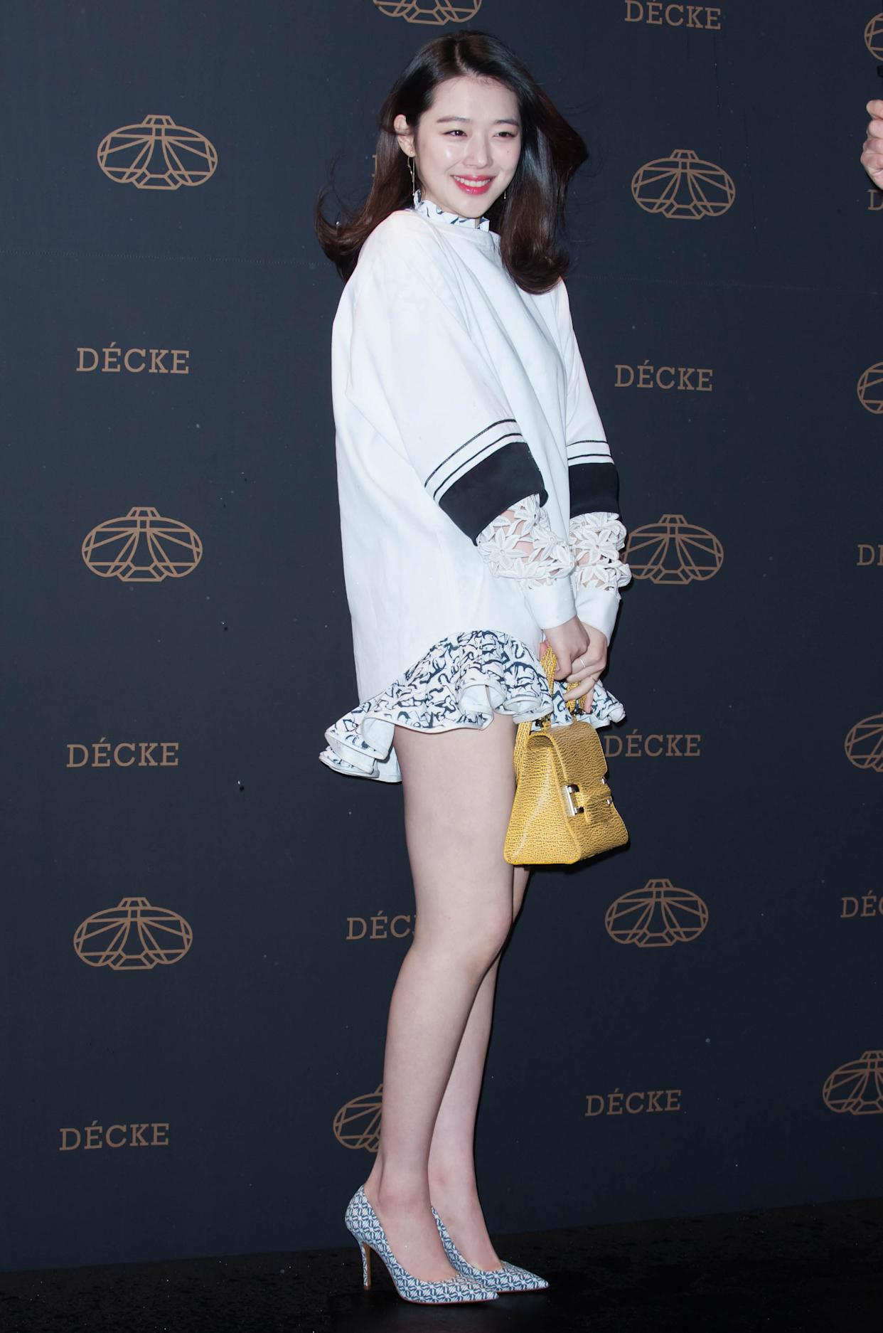SEOUL, SOUTH KOREA - MARCH 20:  Sulli of f(x) poses for photographs during the DECKE flagship store opening event on March 20, 2014 in Seoul, South Korea.  (Photo by Choi Soo-Young/Multi-Bits via Getty Images)