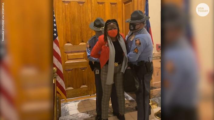 Democratic state Rep. Park Cannon was arrested after knocking on the door of Governor Brian Kemp's office as he signed the elections legislation.