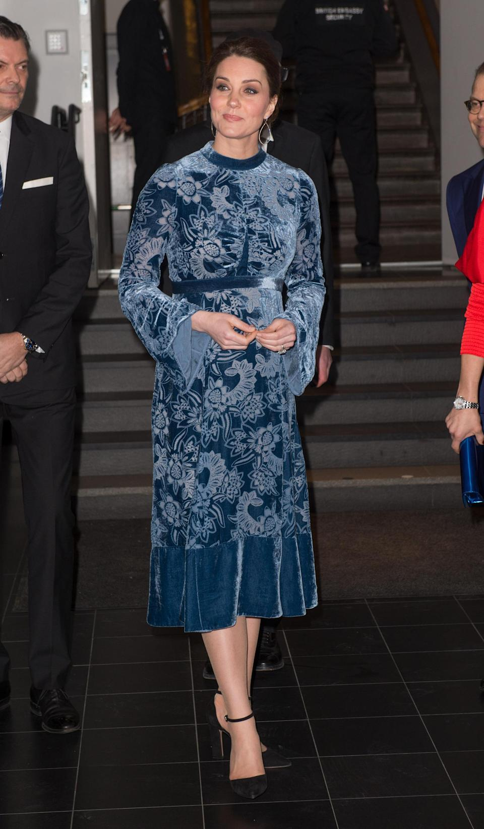 <p>The Duchess of Cambridge chose a velvet Erdem midi dress for the final night of the royal tour of Sweden. She accessorised the £2,690 look with a pair of earrings by Robinson Pelham and Gianvito Rossi heels. <em>[Photo: Getty]</em> </p>