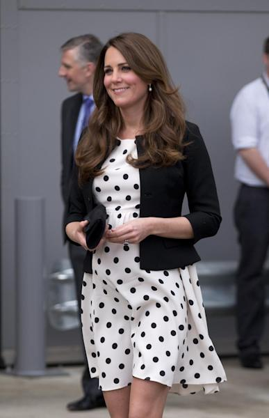 "Britain's Kate the Duchess of Cambridge arrives with her husband Prince William and his brother Prince Harry, both not pictured, to attend the inauguration of ""Warner Bros. Studios Leavesden"" near Watford, approximately 18 miles north west of central London, Friday, April 26, 2013. As well as attending the inauguration Friday at the former World War II airfield site, the royals will undertake a tour of Warner Bros. ""Studio Tour London - The Making of Harry Potter"", where they will view props, costumes and models from the Harry Potter film series. (AP Photo/Matt Dunham)"
