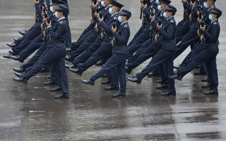 Hong Kong police show their new goose step marching style on the National Security Education Day at a police school in Hong Kong Thursday, April 15, 2021. Authorities marked the event with a police college open house, where police personnel demonstrated the Chinese military's goose step march, replacing British-style foot drills from the time Hong Kong was ruled by the U.K. until the 1997 handover to China. (AP Photo/Vincent Yu)