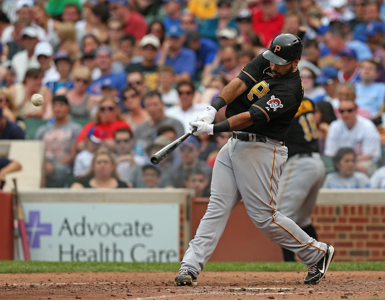 CHICAGO, IL - JULY 06: Pedro Alvarez #24 of the Pittsburgh Pirates hits a solo home run in the 4th inning against the Chicago Cubs at Wrigley Field on July 6, 2013 in Chicago, Illinois. (Photo by Jonathan Daniel/Getty Images)