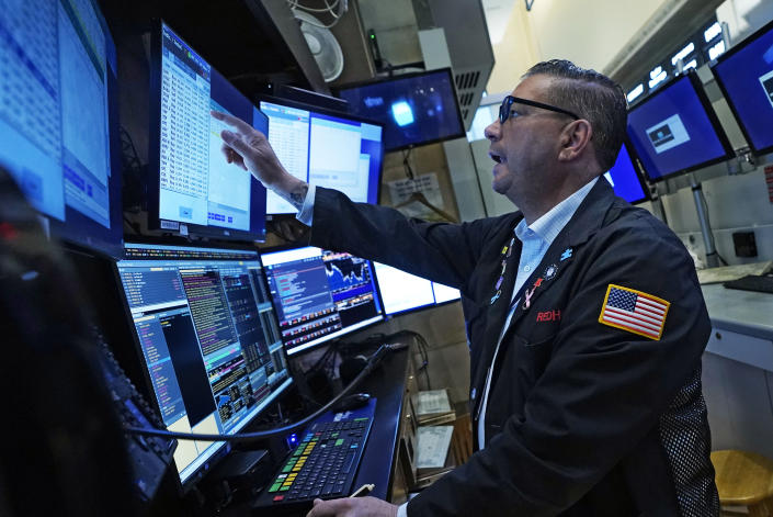 Trader Jonathan Mueller works in his booth on the floor of the New York Stock Exchange, Tuesday, Sept. 21, 2021. Stocks are opening modestly higher on Wall Street, making up some of the ground they lost in a sharp pullback a day earlier. (AP Photo/Richard Drew)