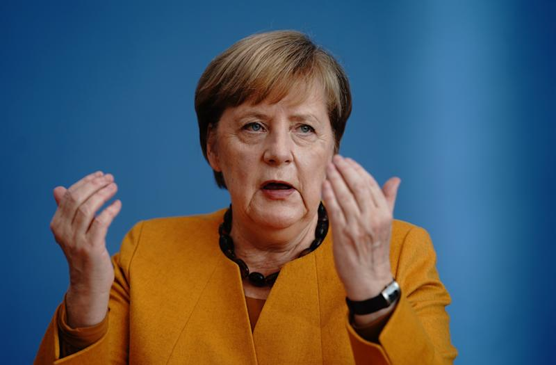 Merkel says 'virus punishes half-heartedness' as partial ...