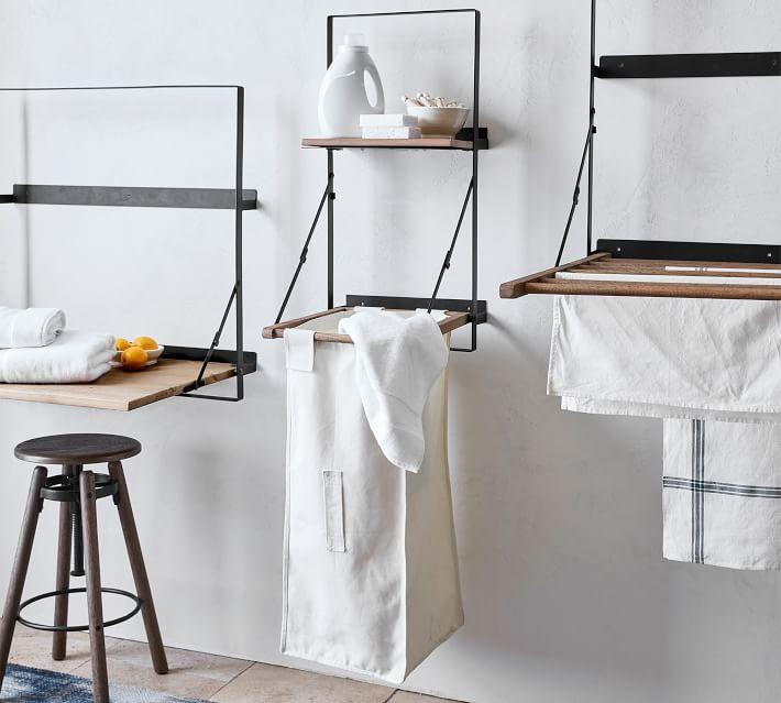 "<h3><a href=""https://www.potterybarn.com/products/trenton-laundry-bag-holder-and-shelf/"" rel=""nofollow noopener"" target=""_blank"" data-ylk=""slk:Pottery Barn Laundry Bag Holder & Shelf"" class=""link rapid-noclick-resp"">Pottery Barn Laundry Bag Holder & Shelf</a></h3><br><strong>When you don't have a closet to hide a hamper in</strong>: Instead of letting your dirty laundry pile up on the floor, store it inside this minimalist wall-mounted solution that boasts a shelf for storing your detergent.<br><br><strong>Pottery Barn</strong> Trenton Laundry Bag Holder & Shelf, $, available at <a href=""https://go.skimresources.com/?id=30283X879131&url=https%3A%2F%2Fwww.potterybarn.com%2Fproducts%2Ftrenton-laundry-bag-holder-and-shelf%2F"" rel=""nofollow noopener"" target=""_blank"" data-ylk=""slk:Pottery Barn"" class=""link rapid-noclick-resp"">Pottery Barn</a>"