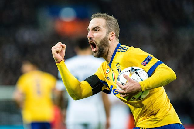 "<a class=""link rapid-noclick-resp"" href=""/soccer/players/gonzalo-higuaín"" data-ylk=""slk:Gonzalo Higuain"">Gonzalo Higuain</a> scored one of the goals that sent <a class=""link rapid-noclick-resp"" href=""/soccer/teams/juventus/"" data-ylk=""slk:Juventus"">Juventus</a> through to the Champions League quarterfinals ahead of Tottenham and assisted on the other. (Getty)"