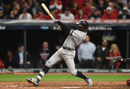 Oct 11, 2017; Cleveland, OH, USA; New York Yankees shortstop Didi Gregorius (18) hits a single during the fifth inning of game five of the 2017 ALDS playoff baseball series against the Cleveland Indians at Progressive Field. Ken Blaze-USA TODAY Sports