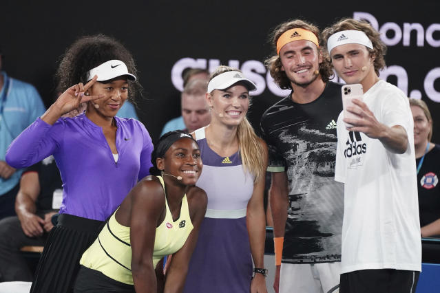 From left, Naomi Osaka of Japan, Coco Gauff of the United States, Caroline Wozniacki of Denmark, Stefanos Tsitsipas of Greece, and Alexander Zverev of Germany pose for a selfie during the Rally For Relief at Rod Laver Arena in Melbourne, Wednesday, Jan. 15, 2020. Tennis stars have come together for the Rally for Relief to raise money in aid of the bushfire relief efforts across Australia. (Scott Barbour/AAP Image via AP)
