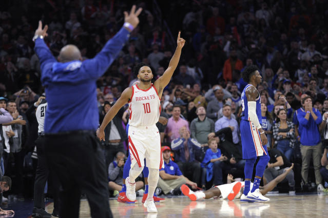 "<a class=""link rapid-noclick-resp"" href=""/nba/players/4469/"" data-ylk=""slk:Eric Gordon"">Eric Gordon</a> celebrates. You can do that when you win. (AP)"