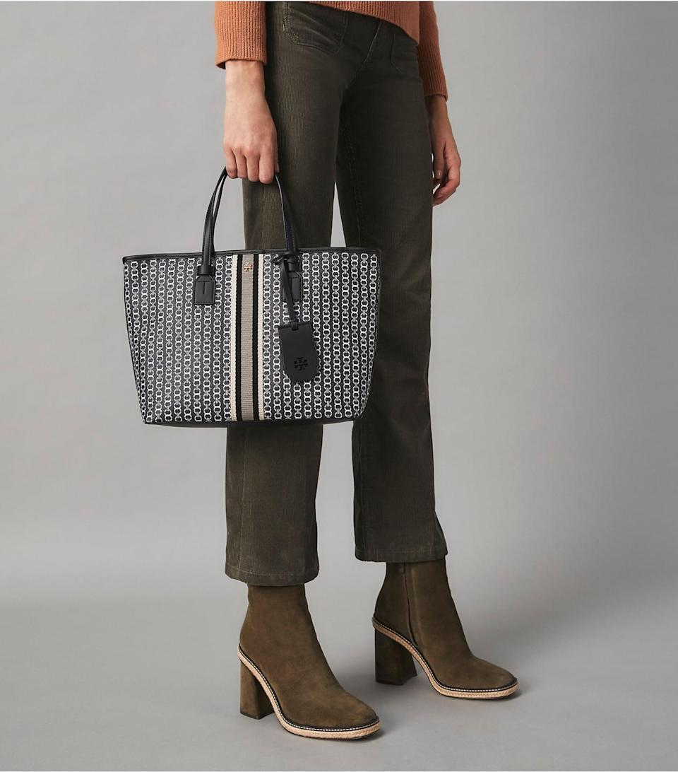 <p>This useful, classic <span>Tory Burch Gemini Link Canvas Small Top-Zip Tote Bag</span> ($228) will make them so happy.</p>