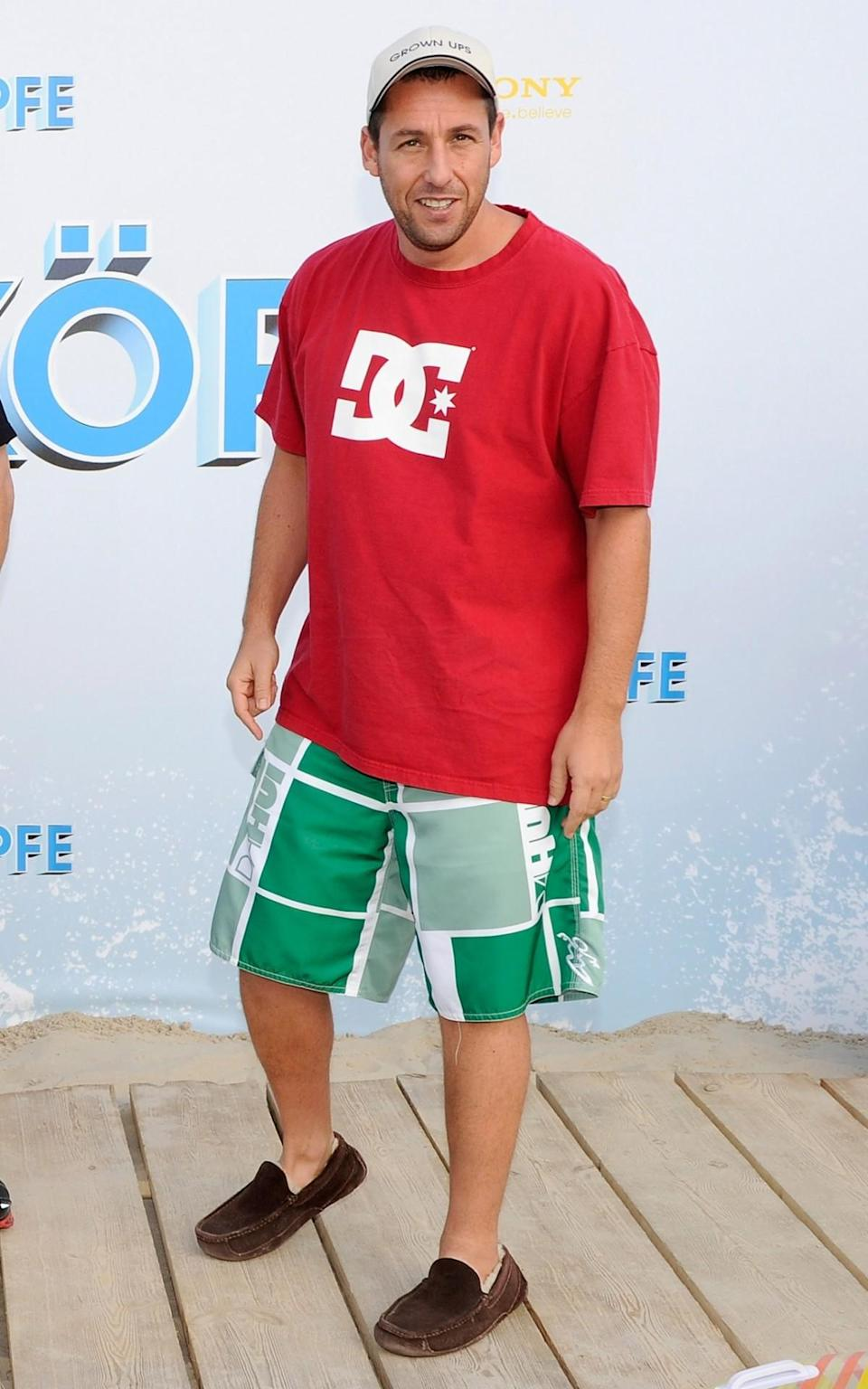 <p>Sandler broke out the board shorts (and slippers) to spread the word about <i>Grown Ups</i> in Berlin. (Photo: Toni Passig/WireImage)</p>
