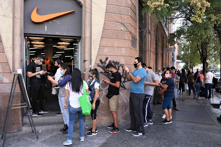 "MONTERREY, MEXICO - NOVEMBER 09: People line up to enter the Nike store during ""Buen Fin"" shopping day on November 9, 2020 in Monterrey, Mexico. (Photo by Medios y Media/Getty Images)"