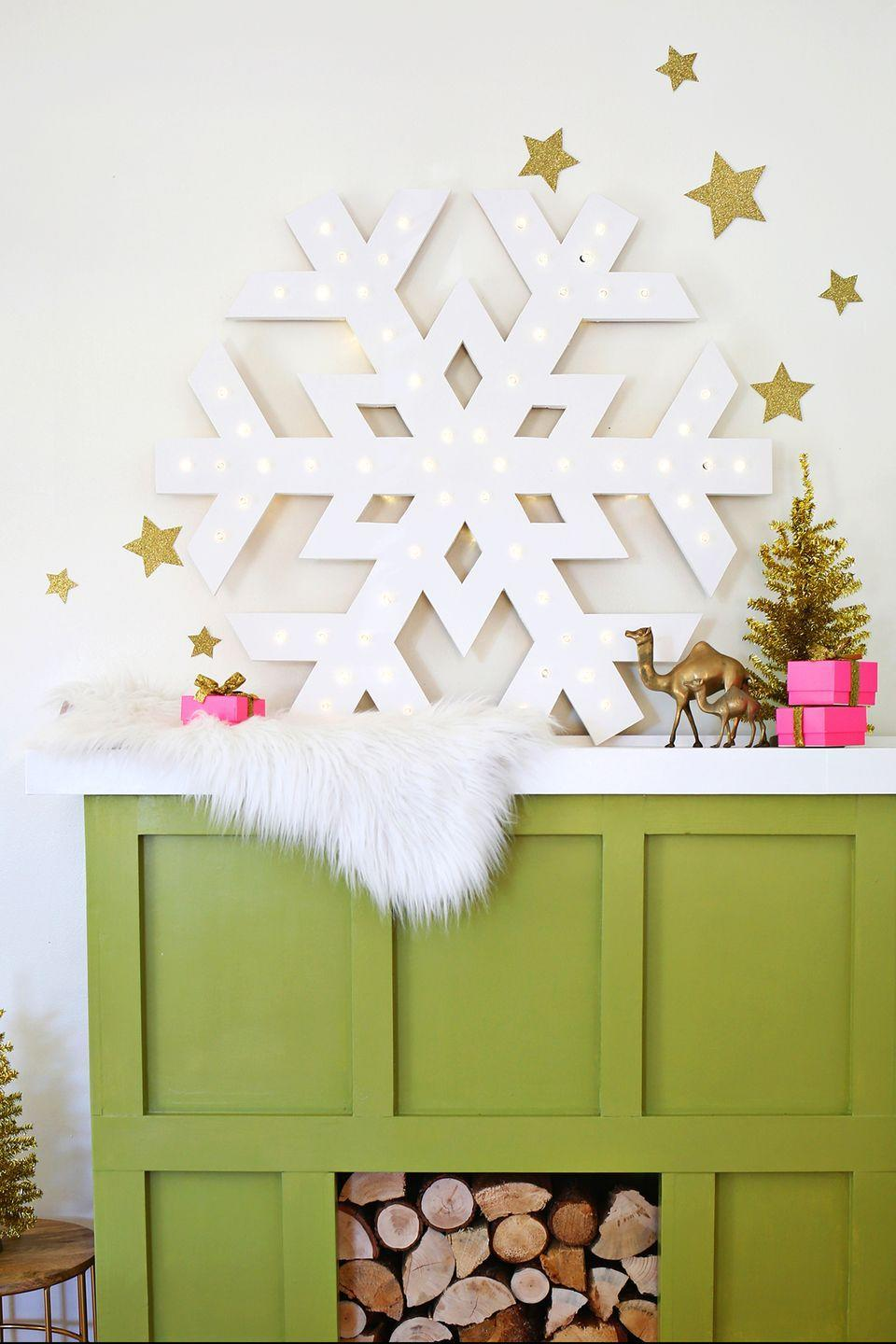 """<p>This light is a slightly more advanced DIY project, but its beauty makes it well worth the extra effort.</p><p><strong>Get the tutorial at <a href=""""https://abeautifulmess.com/2014/11/giant-snowflake-light-up-marquee.html"""" rel=""""nofollow noopener"""" target=""""_blank"""" data-ylk=""""slk:A Beautiful Mess"""" class=""""link rapid-noclick-resp"""">A Beautiful Mess</a>.</strong></p><p><strong><a class=""""link rapid-noclick-resp"""" href=""""https://www.amazon.com/Koopower-Battery-Operated-String-Lights-Outdoor-Waterproof-Dimmable/dp/B015Q7VOOM/?tag=syn-yahoo-20&ascsubtag=%5Bartid%7C10050.g.23489557%5Bsrc%7Cyahoo-us"""" rel=""""nofollow noopener"""" target=""""_blank"""" data-ylk=""""slk:SHOP STRING LIGHTS"""">SHOP STRING LIGHTS</a><br></strong></p>"""