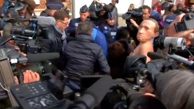 Topless Femen protesters try to storm polling station in France