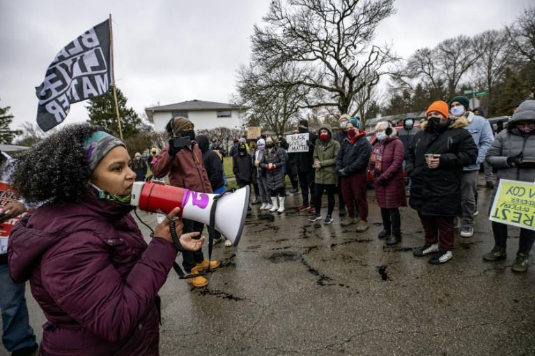 Protestors demonstrate against the police killing of Andre Hill in Columbus, Ohio, which sparked a fresh wave of outrage against racial injustice and police brutality