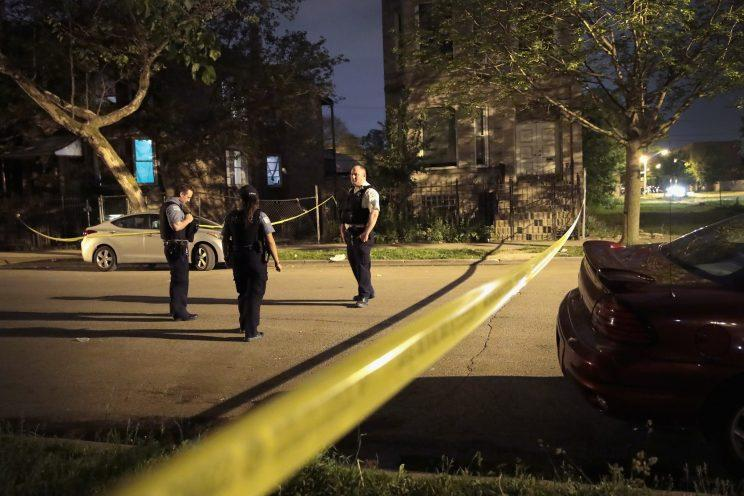 Police investigate the scene of a shooting on May 27, 2017, in Chicago.