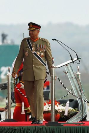 Pakistan's Army Chief of Staff General Qamar Javed Bajwa, walks as he arrives to attend the Pakistan Day military parade in Islamabad,