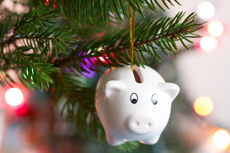 Save money and christmas concept with piggy bank and tree business abstract