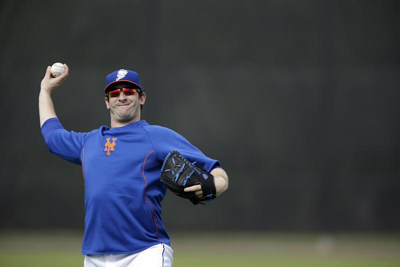 New York Mets pitcher Matt Harvey plays catch during spring training baseball practice Saturday, Feb. 22, 2014, in Port St. Lucie, Fla. Harvey underwent Tommy John surgery on Oct. 22