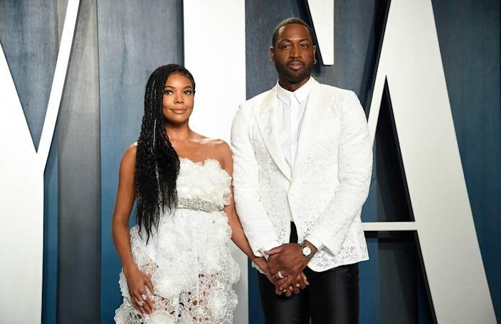 Gabrielle Union, left, and husband Dwyane Wade arrive at the Vanity Fair Oscar Party on Sunday, Feb. 9, 2020, in Beverly Hills, Calif. (Photo by Evan Agostini/Invision/AP)