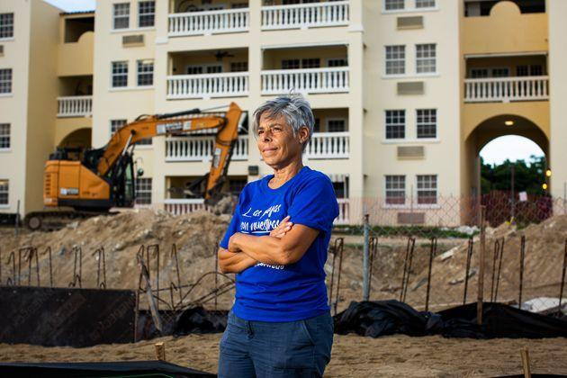 Miriam Juan Rivera, a community leader, stands in front of the Playa y Sol complex at Los Almendros beach on Aug. 2. She was one of the first to join an encampment on the beach to protest the reconstruction of the complex's pool in a nesting area for endangered turtles. (Photo: Erika P. Rodriguez for HuffPost)