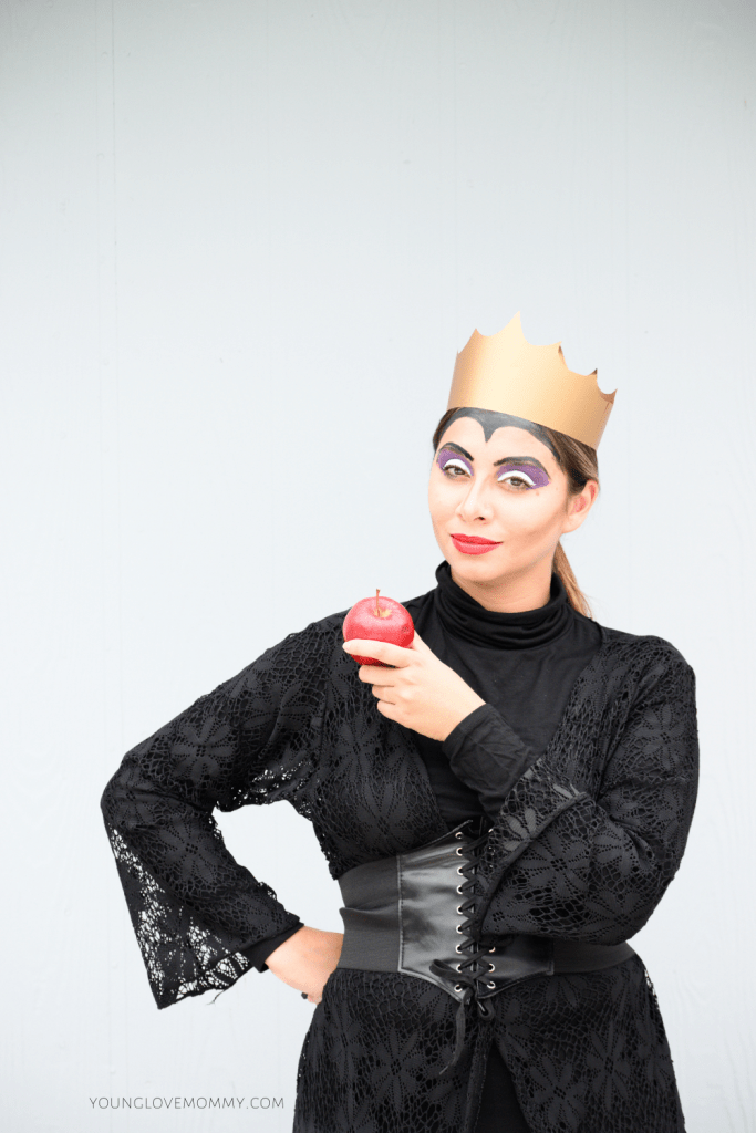 """<p>The crown may be paper, but the apple is real in this version of the Evil Queen that includes a nifty widow's peak made from makeup.</p><p><strong>Get the tutorial at <a href=""""https://www.younglovemommy.com/2020/10/diy-evil-queen-costume/"""" rel=""""nofollow noopener"""" target=""""_blank"""" data-ylk=""""slk:Young Love Mommy"""" class=""""link rapid-noclick-resp"""">Young Love Mommy</a>.</strong></p><p><a class=""""link rapid-noclick-resp"""" href=""""https://www.amazon.com/gp/product/B017E8TT3Y/ref=as_li_ss_tl?tag=syn-yahoo-20&ascsubtag=%5Bartid%7C10050.g.36674692%5Bsrc%7Cyahoo-us"""" rel=""""nofollow noopener"""" target=""""_blank"""" data-ylk=""""slk:SHOP CORSETS"""">SHOP CORSETS</a></p>"""