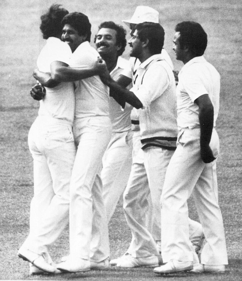 Indian team captain Kapil Dev, second from left, hugs Indian bowler Madan Lal while the rest of the Indian team jubilate at Lord's after Gavaskar had caught West Indian, Larry Gomes, for five of the bowling of Madan Lal during the Prudential World Cup Final in London, June 25, 1983. (AP Photo/Peter Kemp)