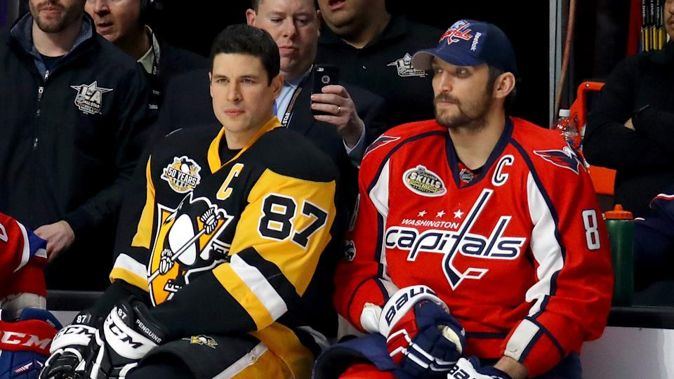 Will Sidney Crosby, left, and Alex Ovechkin both miss the playoffs this year? (Photo by Bruce Bennett/Getty Images)