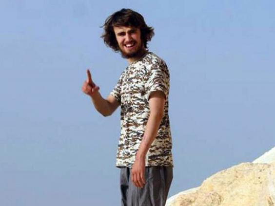 The jury was shown a photo of Jack Letts posing at the Tabqa Dam outside Raqqa (Facebook)