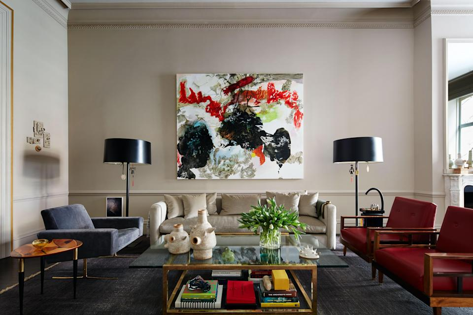The painting in the living room is by Argentinean Brooklyn-based artist Alejandra Sever. The central sofa was custom designed and wears a cashmere velvet from Great Plains at Holly Hunt. Otero is a stickler for proportion and decided to maximize the size to fit the space. He also designed the floor lamps in dark steel with a special patina. The vintage Italian lounge chair with brass legs was reupholstered in a gray-blue suede by Edelman.