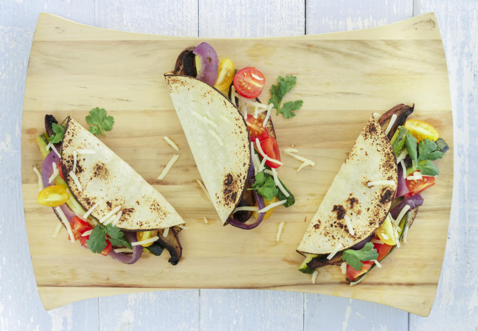 """<p>What's more fun that building tacos for dinner? And who says you need meat. Try this recipe for Honey-Lime Sweet Potato, Black Bean and Corn Tacos from the <a rel=""""nofollow noopener"""" href=""""https://www.cookingclassy.com/honey-lime-sweet-potato-black-bean-and-corn-tacos/"""" target=""""_blank"""" data-ylk=""""slk:Cooking Classy blog"""" class=""""link rapid-noclick-resp"""">Cooking Classy blog</a> for a break from the norm? [Photo: Getty] </p>"""