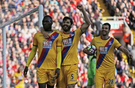 Britain Football Soccer - Liverpool v Crystal Palace - Premier League - Anfield - 23/4/17 Crystal Palace's Christian Benteke celebrates scoring their second goal with team mates  Action Images via Reuters / Paul Childs Livepic
