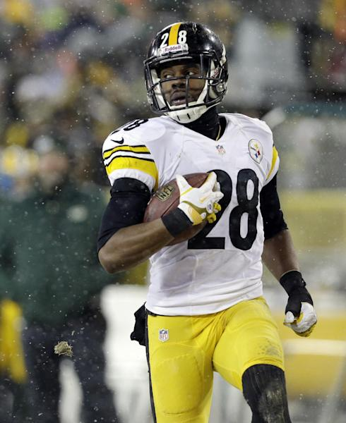 Pittsburgh Steelers' Cortez Allen returns an interception 40 yards for a touchdown during the second half of an NFL football game against the Green Bay Packers Sunday, Dec. 22, 2013, in Green Bay, Wis. (AP Photo/Mike Roemer)