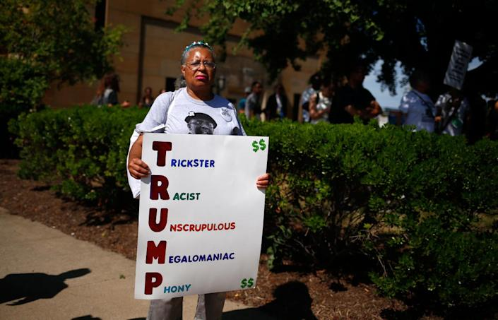 <p>Renla Session holds up a placard during a march ahead of the Republican National Convention in Cleveland, Ohio, on July 17, 2016. (Photo: Shannon Stapleton/Reuters)</p>