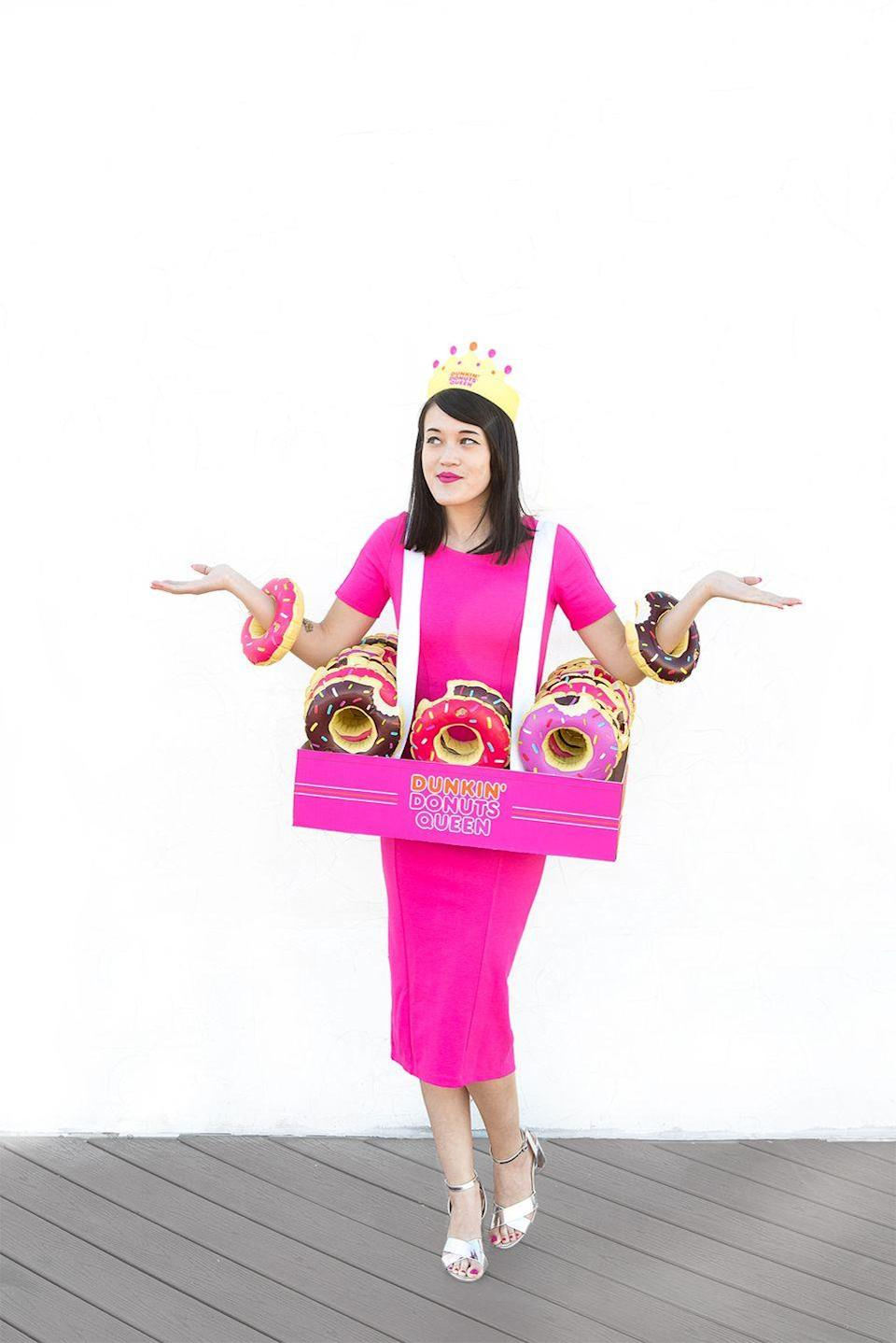 """<p>If you're Team Dunkin', here's an easy way to show your pride using bright colors and mini blow-up donuts. </p><p><a class=""""link rapid-noclick-resp"""" href=""""https://www.amazon.com/HansGo-Inflatable-Floating-Coasters-Doughnut/dp/B07CJ5QRF2/?tag=syn-yahoo-20&ascsubtag=%5Bartid%7C10055.g.2750%5Bsrc%7Cyahoo-us"""" rel=""""nofollow noopener"""" target=""""_blank"""" data-ylk=""""slk:SHOP INFLATABLE DONUTS"""">SHOP INFLATABLE DONUTS</a></p><p><em><a href=""""http://www.awwsam.com/2016/10/diy-donut-queen-costume.html"""" rel=""""nofollow noopener"""" target=""""_blank"""" data-ylk=""""slk:See more on Aww Sam »"""" class=""""link rapid-noclick-resp"""">See more on Aww Sam »</a></em></p>"""
