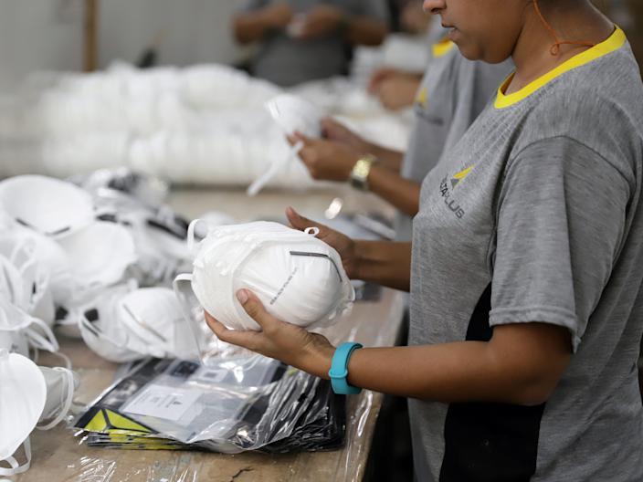 Labourers work on PFF2 respirator masks at Delta Plus plant in Socorro, Sao Paulo state, Brazil March 3, 2020. Picture taken March 3, 2020.