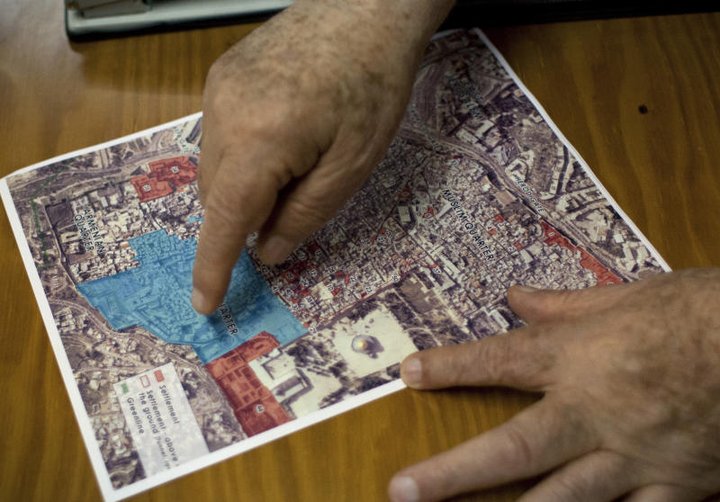 In this photo taken Monday, Sept. 9, 2013, former Palestinian Prime Minister and negotiator Ahmed Qureia points on a map that shows the large expansion, following the 1993 Oslo agreement, of the Israeli controlled quarter of Jerusalem, during an interview with The Associated Press at his office in the West Bank town of Abu Dis, east of Jerusalem. Twenty years after the two sides signed the Declaration of Principles on the White House lawn, the words that launched Israeli-Palestinian talks on dividing the Holy Land into two states ring hollow to many on both sides. Negotiators said mistakes they made then cause damage to this day. (AP Photo/Nasser Nasser)