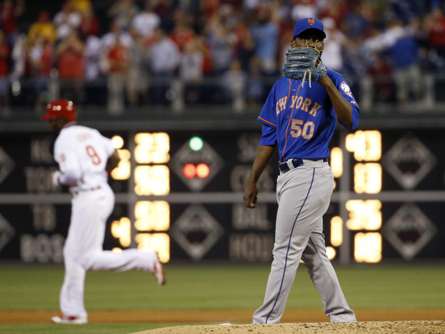 New York Mets starting pitcher Rafael Montero, right, wipes his face after giving up a three-run home run to Philadelphia Phillies' Domonic Brown during the fourth inning of a baseball game, Friday, May 30, 2014, in Philadelphia. (AP Photo/Matt Slocum)